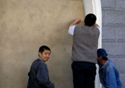 Kyrgyz boarding a window to a shop before the protests