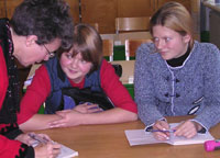 Jeannie Ferber with two students in a Russian village.