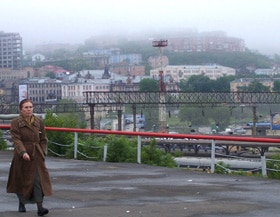 A woman strolls the hilly streets of Vladivostok