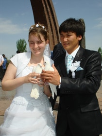 Genna and Rakhat prepare to release doves as part of the Kyrgyz wedding festivities.