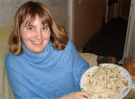 Genna with a plate of Beshbarmak, a traditional Kyrgyz dish
