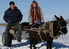 Genna and Rakhat pictured on a traditional donkey cart in winter