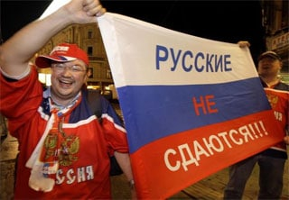 Russian Hockey Fans celebrate in Moscow after Russia won the 2008 world championship.