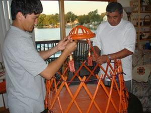 Rakhat and his father assembling the miniature yurt for the wedding.