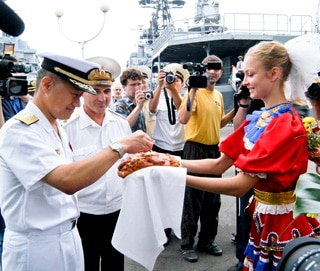 Officers from a visiting Japanese destroyer are greeted with traditional Russian bread and salt in 2007