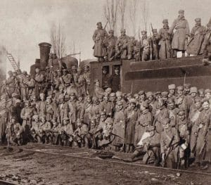 Soldiers from the Czech Legion posing near a rail car.