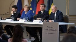 Vladimir Putin, Emmanuel Macron, Angela Merkel and Vladimir Zelenskiy at the Normandy Four summit in 2019