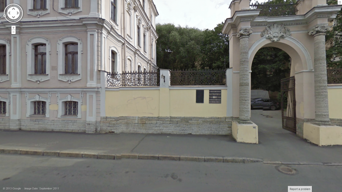 The small gate to the left is the entrance.